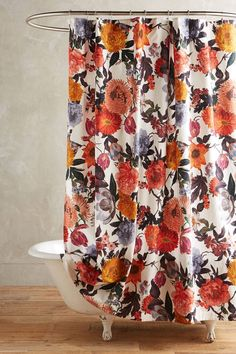 This bold, floral shower curtain pairs well with the antique clawfoot tub.