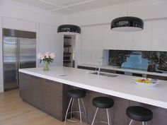 wood + white + black kitchen by jessop architects