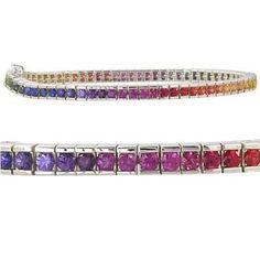 Rainbow Sapphire Tennis Bracelet-12 carats of 2.8mm round cut channel set rainbow sapphires set in 925 sterling silver. $889 #bracelet #jewelry