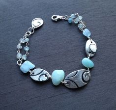 Aquamarine Bracelet - handcrafted in fine silver(.999%) by BitsofSilver ; length at 7.25, all other metals in sterling silver wire wrapped with genuine aquamarine stones.Aquamarine is the birthstone for March.($45)