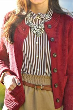 White striped blouse, statement necklace, red cardigan and khaki skirt with leather skinny belt.