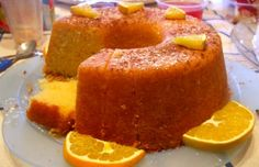 Portuguese Moist Orange Cake Recipe You can make this sweet, delicious and moist Portuguese orange cake in about 50 minutes, enjoy it. Portuguese Desserts, Portuguese Recipes, Portuguese Food, Portuguese Sweet Bread, Sweet Recipes, Cake Recipes, Dessert Recipes, Orange Recipes, Food Cakes