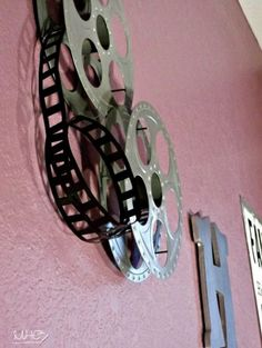Will add some film reels to my tv room...Good Idea.