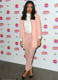 Pretty in pastels: Sarah Jane Crawford turned heads in a pink jacket and trousers, which s...
