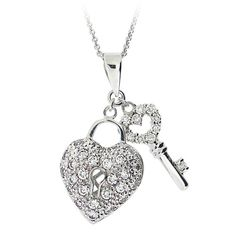 This sterling silver heart key necklace is sure to become one of your most favorite accessories. The heart locket and key that matches are adorned in white cubic zirconia. The pendant is finished with a high-polished shine and dangles from a rolo chain.