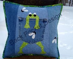 Upcycle your old pair of 100% cotton jeans into fun, whimsical pillows! This pattern is an original design and is a hard copy mailed right to you!  This original pattern includes directions on how to:  - Filet your old jeans to get the most out of the old, soft, velvety denim! - How to satin stitch applique. This is a very durable way to applique. - Templates for the Frog and Fly parts - Directions on how to assemble the 16 x 16 pillow.  This cozy pillow is fun to hug, great for naps and…