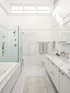 High windows give privacy and great natural light! Master bathroom - Contemporary - Bathroom - Dc Metro - Harry Braswell Inc. Marble Bathroom Floor, Floating Bathroom Vanities, White Marble Bathrooms, Narrow Bathroom, Bathroom Flooring, Floating Vanity, Marble Floor, Tile Floor, Floating Cabinets