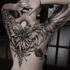 black work wings tattoo idea on the back