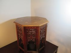 """Middle Eastern Rosewood End Table $500.00 This octagon shaped table speaks on its own, with its simple gold designs and intense wood carved patterns between each set of legs. Boy, this piece well leave your guest speechless! 25 1/8"""" H x 23 3/4"""" W x 24"""" L  https://squareup.com/market/our-sister-company/middle-eastern-rosewood-end-table"""