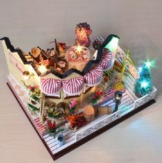 Diy dollhouse vanilla wooden toy assembling model house day gift $58.45 **I have bought from this seller and they are reliable. the kits are completely DIY and include EVERYTHING you see in the pictures including the lights.**