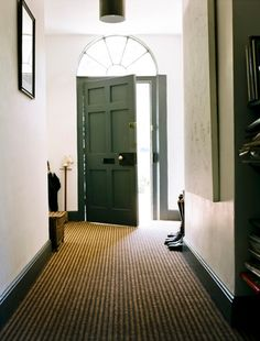 Lengthen the space with striped flooring Stripes can lengthen or widen the look of a space depending on which way the pattern runs. Choose striped flooring with the pattern running down the length of the space to make it look longer. House Entrance, Entrance Hall, Window Above Door, Hallway Designs, Hallway Ideas, Striped Carpets, Sisal Carpet, Hallway Flooring, Natural Flooring