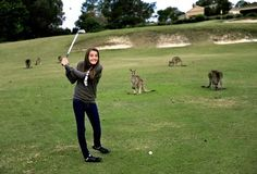 My daughter Valentina playing golf with the kangaroos at the Lakeside golfcourse, Gold Coast Queensland
