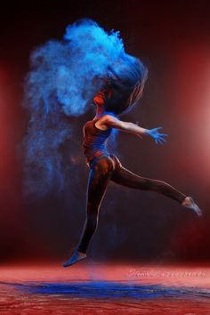 girl with colored powder - girl with colored powder exploding around her and into the background.