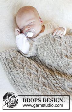 Afternoon Nap / DROPS Baby 31-16 - Gebreide deken met kabels voor baby. Het werk wordt gebreid in DROPS BabyMerino.