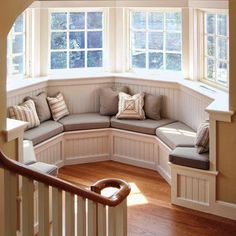 round window seat nook at stair landing
