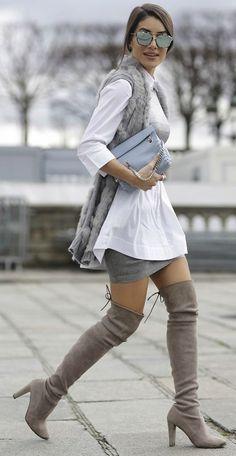 Thigh high boots + essential + high class + sophisticated style + Camila Coelho + right idea + grey vest + mini skirt + boots  Shirt: Topshop, Top: Glória Coelho, Boots: Stuart Weitzman.