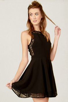 NELLIE LACE DRESS by Sugarlips – BKLN Black circle lace fit and flare dress. Features a solid black panel in the front. Invisible zipper closure on back