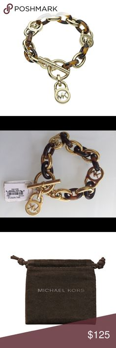 Heritage Link Tortoise Toggle Bracelet From Michael Kors, this stylish toggle bracelet features faux tortoise-shell links and gold toned links accented with the Michael Kors signature logo locks. Bracelet is golden tone and approximately 8 inches in length. $165 Michael Kors Jewelry Bracelets