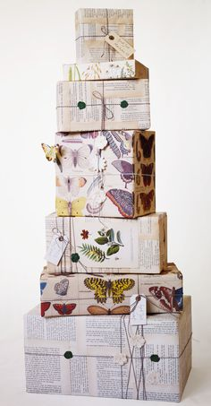 recycled wrappings from old books and magazines, with cotton laces and hand-written labels . by Camilla Furst . Martin Cederblad, photograher