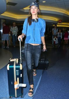 Alessandra Ambrosio lugs two suitcases across LAX in a sweatshirt, jeans and Birkenstocks http://dailym.ai/1qQ4Joi