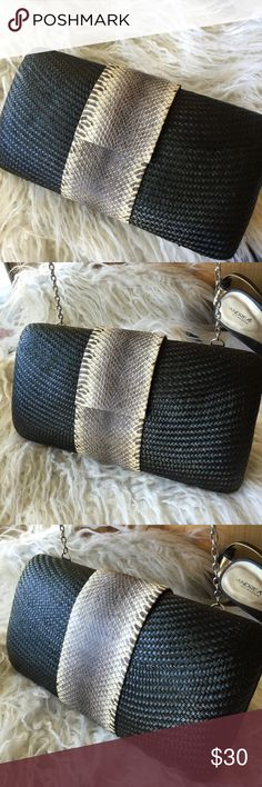 """Snakeskin & wicker clutch /crossbody/ shoulder bag Brand new , never carried evening bag. Woven black wicker body, with snakeskin accent on the center of bag. Lined with black fabric inside zippered pocket. Silver chain tucks inside, or fold it out to carry on shoulder, or crossbody style. Chic & glamorous! 10"""" by 6"""" Bags Clutches & Wristlets"""