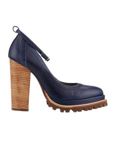 Meadow heel in Navy designed by Karen Walker at www.preciouspeg.com  Karen's Meadow heel as shown at her latest runway show in New York is now available - but be quick we have limited supply. A navy leather shoe with a wooden stacked heel, rounded point toe design and u-bar single strap. Softened with a contrasting brown rubber sole. Lined with a comfortable leather inner. Also available in Tan.  From Karen Walkers 'Garden People' Collection.