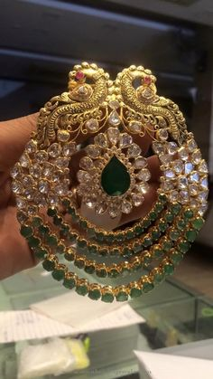 22k gold antique peacock pendant studded with polki stones and emeralds. For inquiries please contact the seller below. Seller Name : Premraj Shantilal Jain Jewellers Address : POT MARKET Opp BATA Rp road,Hyderabad, India 500025. Contact No : 9700009000, 9951000005 Website : http://premshantijewels.blogspot.in/ Facebook : https://www.facebook.com/premrajshantilaljainjewellers/ More CollectionsAntique Gold Emerald Pendant From ArnavGold Antique...