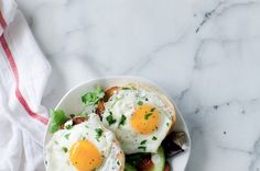 Fried Eggs with Feta over Toasted Sesame Bagel with Leben Dill Spread