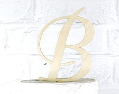 Thank you for visiting and welcome to RusticWeddingStop!  We offer an array of custom unique designs that are personalized with your new last name. Our toppers are made from 1/8 Baltic Birch Wood and have a 2 tall stake.  RusticWeddingStop also offers custom designs based on artwork you provide. If you have a custom design in mind, send it over and we can work with you to create a topper custom tailored to you!  **Have A Smaller or Larger Cake?** We build custom sized toppers all the tim...