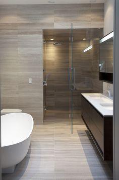 Minimalist Bathroom..... Wetstyle Pedestal Tub, Floating Vanity, Frameless Shower Door  (pinned by Danielle Lake Design, www.daniellelakedesign.com)