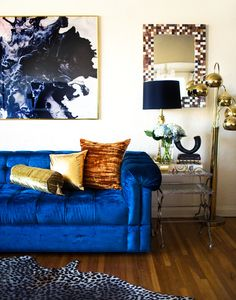 Blue statement furniture with gorgeous blue and gold art accents