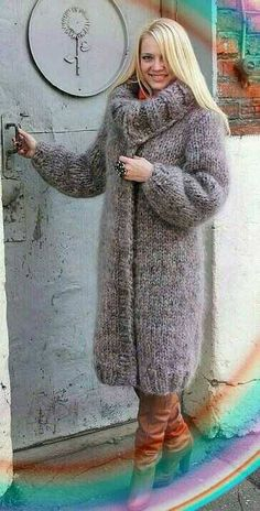 Wool blend winter coat. I love the boots. They the outfit pop!