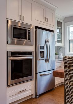 White Shaker Kitchen Cabinets with Espresso Island & Butlers Pantry