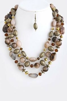 """Brown And Gold Layered Stone Jewel Necklace - Gold Collar Ornament Drape Stone Necklace StarShine Jewelry. $19.50. Lead and nickel compliant. Lobster claw clasp with 3"""" extender. Layered ornament stone necklace. Length approx 22"""""""