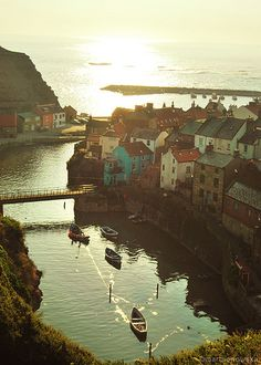 Staithes, England~ when the tied goes out, the water level in the harbour drops so the boats are sitting on the ground. So cool!