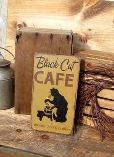 "This wooden sign is made from local NH pine, and measures Approx 14""Tall x 7.5""Wide It reads ""Black Cat Cafe wicked strong coffee"". The front is painted a Mustard Yellow then distressed, the back is s"