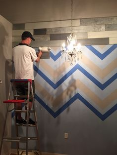"""This is a """"before"""" photo of the metallic wood wall. Goodbye chevron!!!!"""