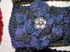 Variegated purple/gray/black.  Crafted flower matches button...yes, intentional.  ;-)