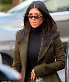 Klassic Kourtney: The Keeping Up With the Kardashians star kept her make-up to her go-to, ...