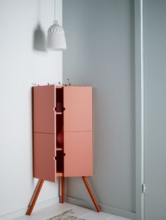 Living room storage solutions: IKEA PS 2014 corner cabinet. Put those empty corners to good use.