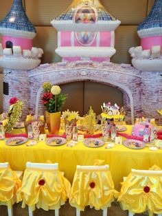 Decorated table and chairs at a  Beauty and the Beast party.  See more party ideas at CatchMyParty.com.  #princessbelle #partyideas
