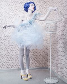 Cool puppetry styled fashion shoot. Loving her dress!