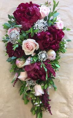 Deep Purple and Pink Waterfall Bride Bouquets. Flowers & Home. 264a Chester Road, Castle Bromwich, Birmingham, B36 0LB. Tel. 0121 730 2443