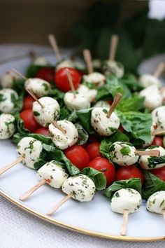 Found on weheartit.com baby mozzarella and tomato spears for appetizers....