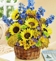 Fields of Europe™ for Summer Basket - sunflowers, delphinium, alstroemeria, yarrow, poms, and more in a charming, handled willow basket #flowers #sunflowers #summer #bright