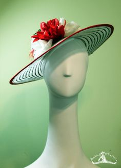 """The """"Dixie"""" Looking for an amazing hat to wear to the Derby or outdoor picnic? This lovely gem is bright and cheerful. Features beautiful red and white flowers, hand-beaded leaves, and hand-stitched red ribbon trimming on a black and white striped wide-brimmed hat. *Mint julep not included. Vintage-inspired but with a modern flair. $105"""