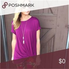 """Magenta Knot Tunic Magenta Knot Tunic. Beautiful color! 95% Rayon 5% Spandex. Length (M) 29"""" (L) 30"""" Bust (M) 25"""" (L) 26 Measured laying flat armpit to armpit. Boutique Tops"""