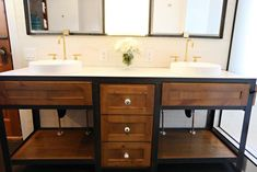 This custom-built metal vanity with wood drawers features vintage drawer pulls, a white concrete countertop, white vessel sinks and a subway tile backsplash.