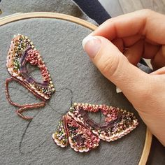 Sewing a beaded brooch using an embroidery hoop to keep the fabric base flat. Sewing a beaded brooch using an embroidery hoop to keep . Bead Embroidery Patterns, Tambour Embroidery, Bead Embroidery Jewelry, Ribbon Embroidery, Beaded Embroidery, Beading Patterns, Beaded Jewelry, Embroidery Stitches, Butterfly Embroidery