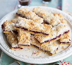 Blackcurrant coconut slices Cut this tasty traybake into bars with a layer of fruit jam in the middle - swap for raspberry, blackberry or gooseberry if you prefer Bbc Good Food Recipes, Fruit Recipes, Dessert Recipes, Cooking Recipes, Yummy Food, Cake Recipes, Recipies, Currant Recipes, Coconut Slice